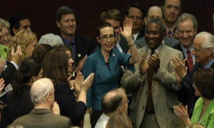U.S. Representative Gabrielle Giffords (D-AZ) (C) waves as she stands with colleagues on the floor of the House of Representatives, moments after the House voted to raise the U.S. borrowing limit, in Washington in this still image taken from video August 1, 2011. Giffords returned to the House floor on Monday for the first time since she was shot in the head in January, receiving a thunderous ovation from Democrats and Republicans alike. Giffords, a Democrat who has not been to Washington since the shooting at a political event in her home state of Arizona, returned to vote in favor of a bill to raise the U.S. debt ceiling and avoid default. (Photo: REUTERS/House TV)