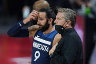 Minnesota Timberwolves guard Ricky Rubio (9) talks with head coach Chris Finch during the first half of an NBA basketball game against the Detroit Pistons, Tuesday, May 11, 2021, in Detroit. (AP Photo/Carlos Osorio)