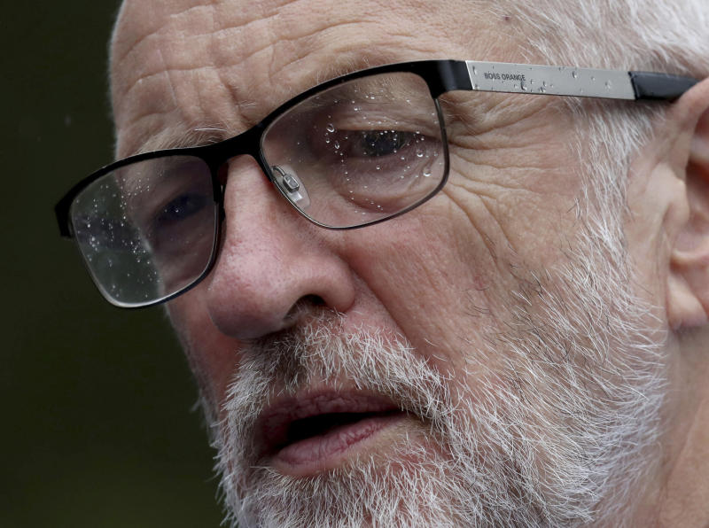 With rain speckled glasses Britain's main opposition Labour Party leader Jeremy Corbyn joins local conservation campaigners during a visit to a green belt preservation project in Calderbank, Scotland, Friday Aug. 30, 2019. Corbyn is conducting a short tour of Scotland. (Andrew Milligan/PA via AP)