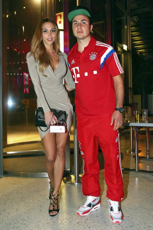 REFILE - ADDING SURNAME OF ANN-KATHRIN Bayern Munich's Mario Goetze and Ann-Kathrin Brommel, also known as Ann-Kathrin Vida, attend the team's after-match party in Berlin May 18, 2014. Bayern Munich restored their undisputed dominance in Germany when they beat rivals Borussia Dortmund 2-0 with two extra-time goals on Saturday to win the German Cup (DFB Pokal) and secure their tenth domestic double. REUTERS/Alexander Hassenstein/Pool (GERMANY - Tags: SPORT SOCCER)