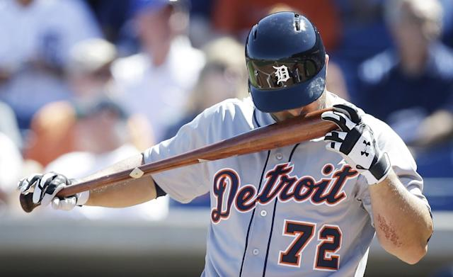 Detroit Tigers right fielder Tyler Collins kisses his bat before hitting in the first inning of an exhibition baseball game against the Philadelphia Phillies Friday, Feb. 28, 2014, in Clearwater, Fla. (AP Photo/Charlie Neibergall)