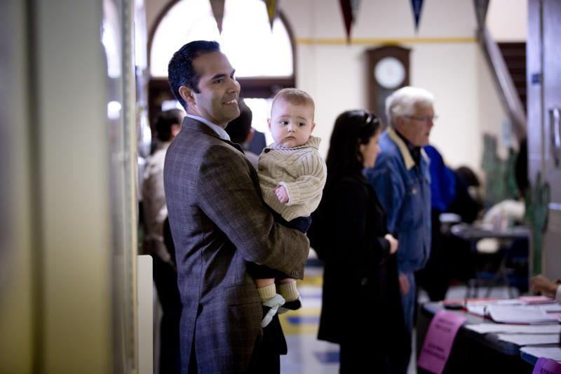 George P. Bush, holding his with son Prescott, turned out to vote in the primary election Tuesday, March 4, 2014, at North High Mount Elementary School in Fort Worth, Texas. The 37-year-old nephew of former President George W. Bush, and son of former Florida Gov. Jeb Bush, is running for land commissioner in the state. (AP Photo/The Fort Worth Star-Telegram, Joyce Marshall) MAGS OUT; (FORT WORTH WEEKLY, 360 WEST)