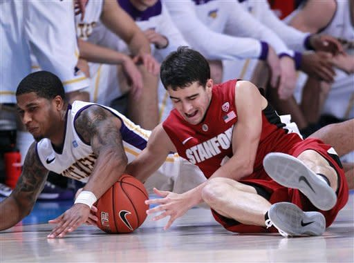 Stanford's Christin Sanders and Northern Iowa guard Deon Mitchell (1) scramble for a loose ball during the first half of an NCAA college basketball game at the Battle 4 Atlantis tournament, Friday, Nov. 23, 2012 in Paradise Island, Bahamas. (AP Photo/John Bazemore)