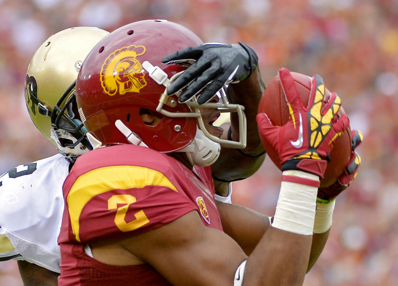 Southern California wide receiver Robert Woods, right, catches a pass for a touchdown as Colorado defensive back Kenneth Crawley defends as during the first half of their NCAA college football game, Saturday, Oct.20, 2012, in Los Angeles. (AP Photo/Mark J. Terrill)