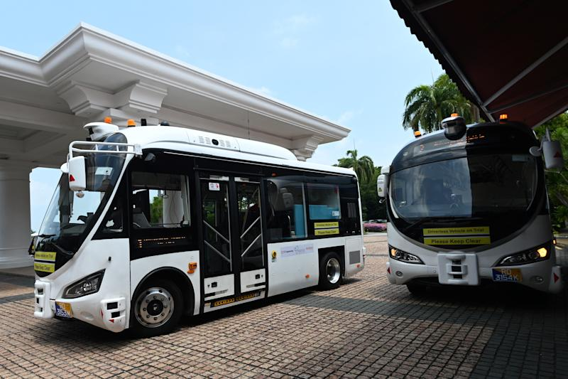 On-demand autonomous shuttle buses are seen during the official launch of a public trial run at Sentosa island resort in Singapore on August 20, 2019. - Singapore will next week begin a public trial of driverless buses that can be booked with an app, part of ambitions to roll out autonomous vehicles across the city-state. (Photo by Roslan RAHMAN / AFP) (Photo credit should read ROSLAN RAHMAN/AFP/Getty Images)