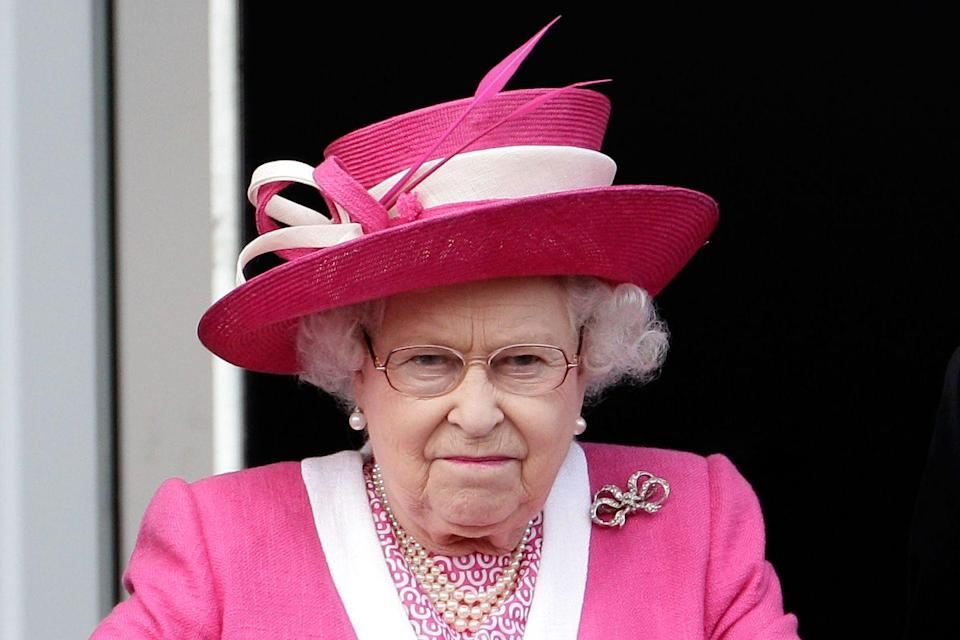 <p>The Queen looks frustrated after her horse (who had been favored to win) places third in the Epsom Derby at Epson Downs. <br></p>