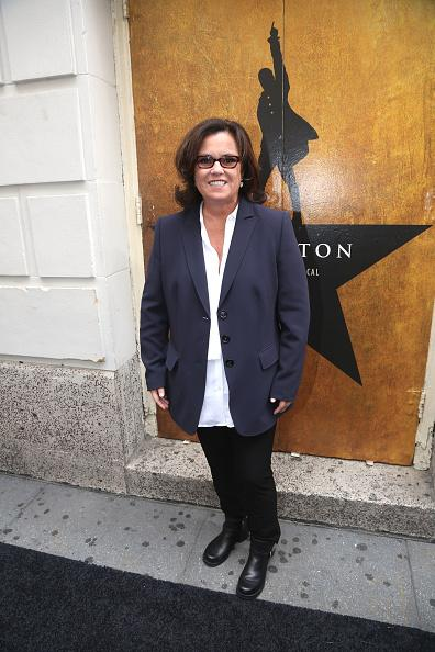 "<p>While Donald Trump was dragging Rosie O'Donnell into the spotlight during the Republican Presidential debate, the talk show host was unaware, taking in ""Hamilton"" wearing a navy blue blazer and tortoise shell glasses. </p>"