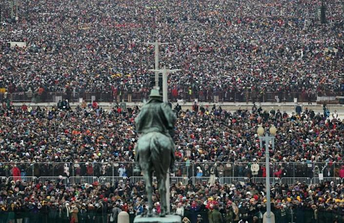 Crowds of people stand on the mall during Barack Obama's 2013 inauguration