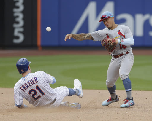 St. Louis Cardinals second baseman Kolten Wong, right, turns a double play over New York Mets' Todd Frazier to end the baseball game at Citi Field, Sunday, June 16, 2019, in New York. The Cardinals defeated the Mets 4-3. (AP Photo/Seth Wenig)