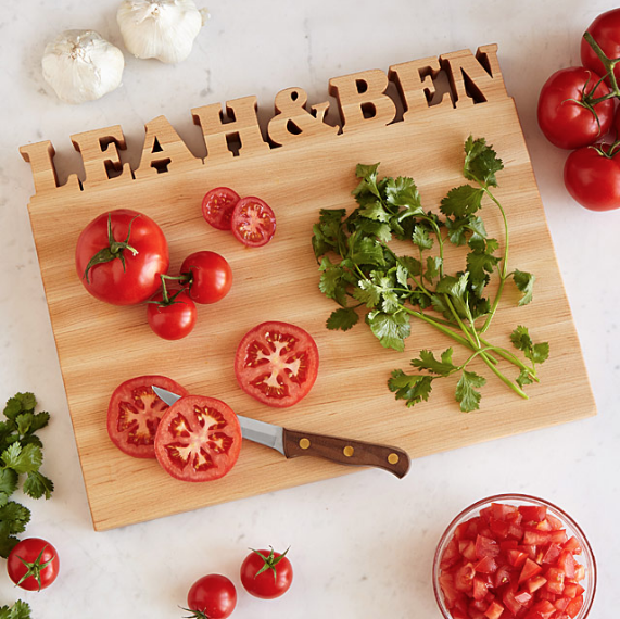 """<p>A cutting board bearing your shared last name is a modern antidote to monogrammed towels.</p><p><strong><em>BUY IT NOW: Personalized Cutting Board, $160; </em></strong><a href=""""https://www.uncommongoods.com/product/personalized-cutting-board"""" rel=""""nofollow noopener"""" target=""""_blank"""" data-ylk=""""slk:Uncommongoods.com"""" class=""""link rapid-noclick-resp""""><strong><em>Uncommongoods.com</em></strong></a></p>"""
