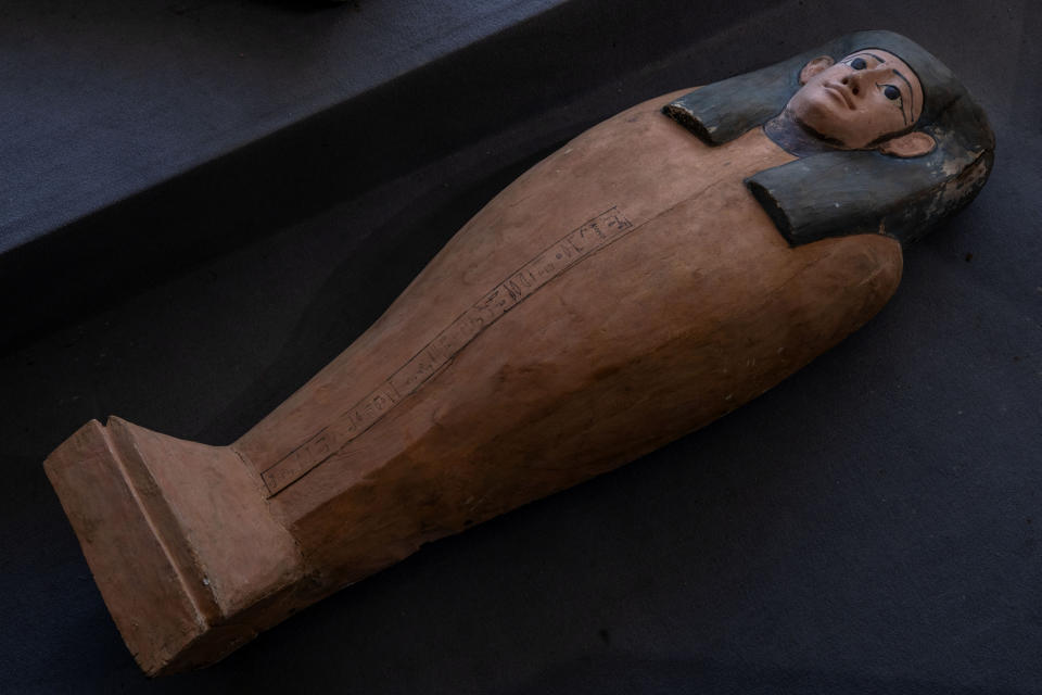 An ancient sarcophagus that buried more than 2500 years ago, is on display in Saqqara, Giza, Egypt, Saturday, Nov. 14, 2020. Egyptian antiquities officials on Saturday announced the discovery of at least 100 ancient coffins, some with mummies inside, and around 40 gilded statues south of Cairo. (AP Photo/Nariman El-Mofty)