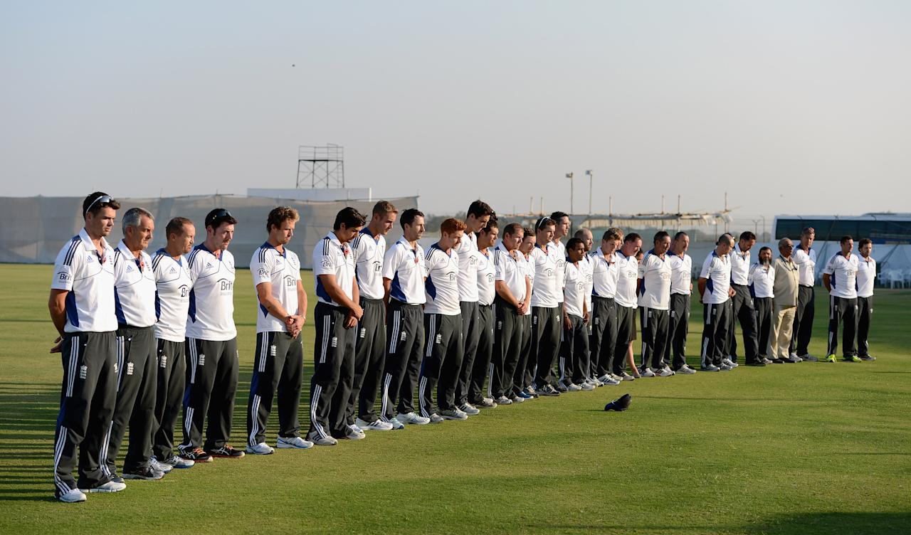 AHMEDABAD, INDIA - NOVEMBER 11:  England players and staff observe a minutes silence to commemorate Remembrance Day during day four of the tour match between England and Haryana at Sardar Patel Stadium ground B on November 11, 2012 in Ahmedabad, India.  (Photo by Gareth Copley/Getty Images)