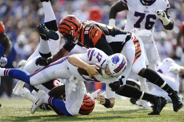 Buffalo Bills quarterback Josh Allen (17) is sacked by Cincinnati Bengals' Carl Lawson (58) and Carlos Dunlap (96). (AP)