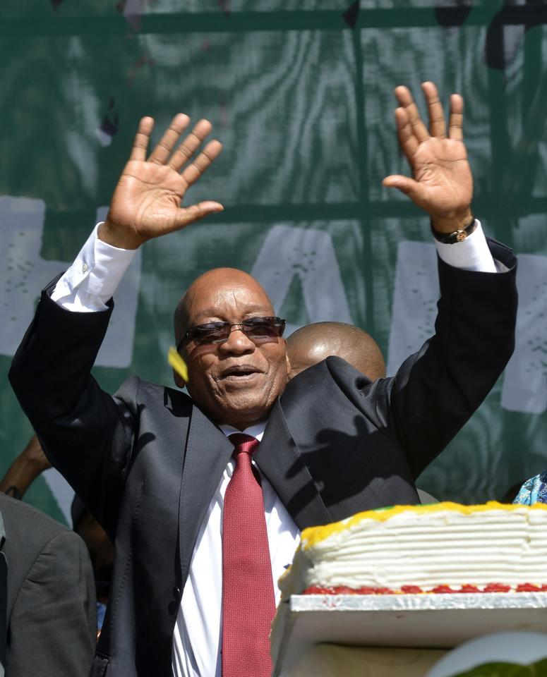 "South Africa's President Jacob Zuma addresses crowds during Freedom Day celebrations at the Union Buildings in Pretoria, April 27, 2014. South Africa marked two decades of multi-racial democracy on Sunday, still feeling the loss of Nelson Mandela and in sombre mood just 10 days before elections which are expected to keep the African National Congress (ANC) party in power.Sunday's celebrations held a special poignancy as this is the first ""Freedom Day"" since the passing of Mandela, the anti-apartheid icon who died in December at the age of 95. REUTERS/Mujahid Safodien (SOUTH AFRICA - Tags: POLITICS ANNIVERSARY)"