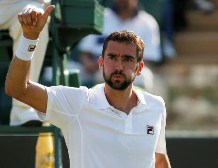 Tennis - Wimbledon - London, Britain - July 5, 2017   Croatia's Marin Cilic celebrates winning the second round match against Germany's Florian Mayer       REUTERS/Andrew Couldridge
