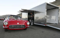 """Jeff Blair, of Colorado Springs, admires his 1956 Chevrolet Corvette at Bandimere Speedway west of Denver on Wednesday, May 5, 2021. The Colorado State Patrol runs a program called """"Take it to the Track"""" in hopes of luring racers away from public areas to a safer and more controlled environment, even allowing participants to race a trooper driving a patrol car. The program's goals have gained new importance and urgency this year as illegal street racing has increased amid the coronavirus pandemic. (AP Photo/Thomas Peipert)"""
