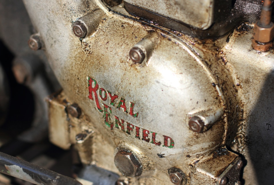 <p>Royal Enfield has a long history dating back to the nineteenth century. It all began with a certain businessman named George Townsend setting up a needle making mill in Redditch, Worcestershire (United Kingdom) in 1851. After his demise, his son George Jr. assumed the mantle. George Jr. soon created a crude bicycle, which he upgraded over the years adding new features. In all the newer models, one thing was a constant – stoutness. The feature is a trademark of all Royal Enfield bikes till date.</p><p>The company gradually started manufacturing other products such as bicycle parts. Soon enough, it bagged a contract to supply precision rifle parts to Royal Small Arms Factory in Enfield, Middlesex. In celebration of this, its new bicycle was called Enfield. A company was created to market the bicycles called The Enfield Manufacturing Co. Ltd in 1892. The next year, the word Royal (after the Royal Small Arms Factory) was added and thus the name Royal Enfield got minted. Their logo was Made Like A Gun.</p>