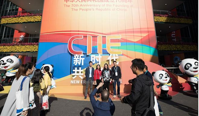 Visitors pose for photos during the second China International Import Expo at the National Exhibition and Convention Centre in Shanghai. Photo: Xinhua