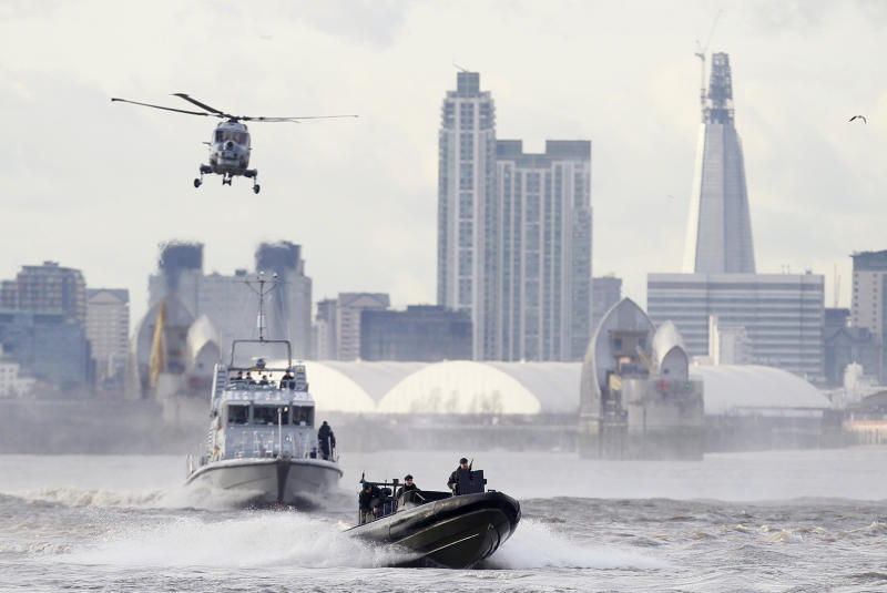 FILE - In this Thursday, Jan. 19, 2012 file photo security forces take part during in a combined British police and British Royal Marines security exercise for the London 2012 Olympic Games on the River Thames in London.  Fighter jets thunder above the English countryside. Missiles stand ready. And Big Brother is watching like never before.   The London Olympics are no ordinary games _and Britain is no ordinary host.  Not since World War II have Britain and the United States teamed up for such a massive security operation on British soil, and not without reason. (AP Photo/Alastair Grant, File)