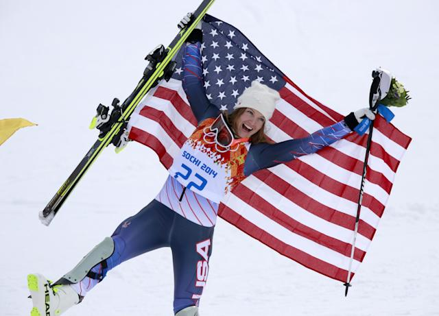 Women's supercombined bronze medalist United States' Julia Mancuso poses with the U.S. flag after a flower ceremony at the Alpine ski venue in the Sochi 2014 Winter Olympics, Monday, Feb. 10, 2014, in Krasnaya Polyana, Russia. (AP Photo/Gero Breloer)