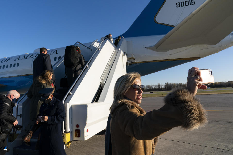 Fox News Laura Ingraham takes a picture before boarding Air Force One to accompany President Donald Trump, at Green Bay Austin Straubel International Airport, Friday, Oct. 30, 2020, in Green Bay, Wis. (AP Photo/Alex Brandon)