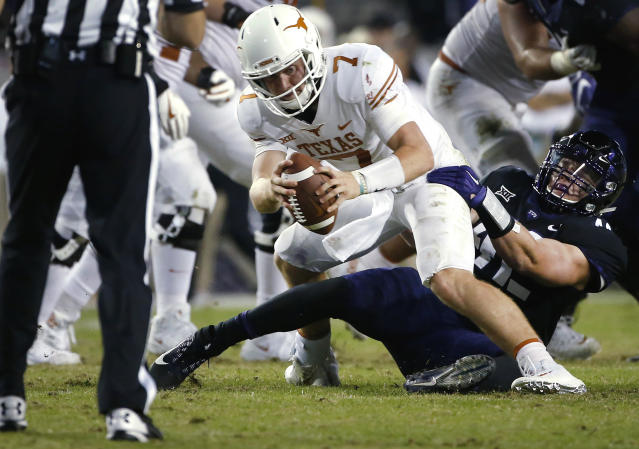 FILE - In this Nov. 4, 2017, file photo, Texas quarterback Shane Buechele (7) is sacked by TCU linebacker Ty Summers (42) during the second half of an NCAA college football game, in Fort Worth, Texas. Summers was an all-district dual-threat quarterback in high school. Since he started playing for No. 15 TCU, Summers has been on the other side chasing quarterbacks and making tackles all over the field. (AP Photo/Ron Jenkins, File)