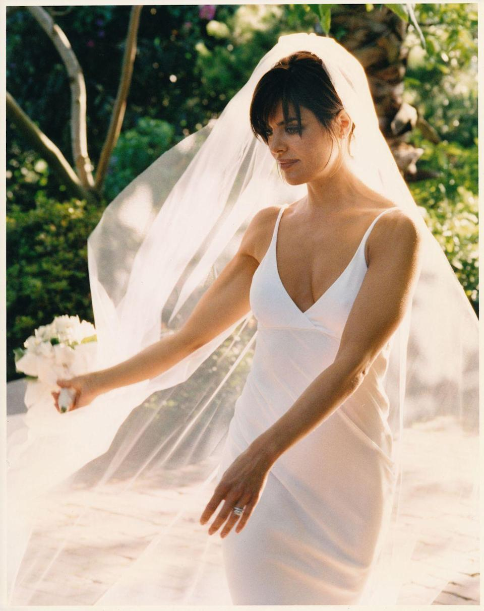 <p>Thanks to Carolyn Bessette, minimal and simplistic bridal styles defined the latter part of the decade—spaghetti straps were a hot trend.</p>