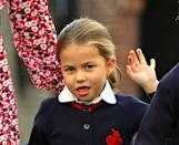 <p>Princess Charlotte makes a silly face as she waves to photographers.</p>
