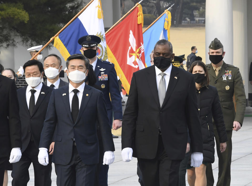 South Korean Defense Minister Suh Wook, center left, and U.S. Defense Secretary Lloyd Austin, center right, walk during their visit to the National Cemetery in Seoul, South Korea, Thursday, March 18, 2021. (Kim Min-hee/Pool Photo via AP)