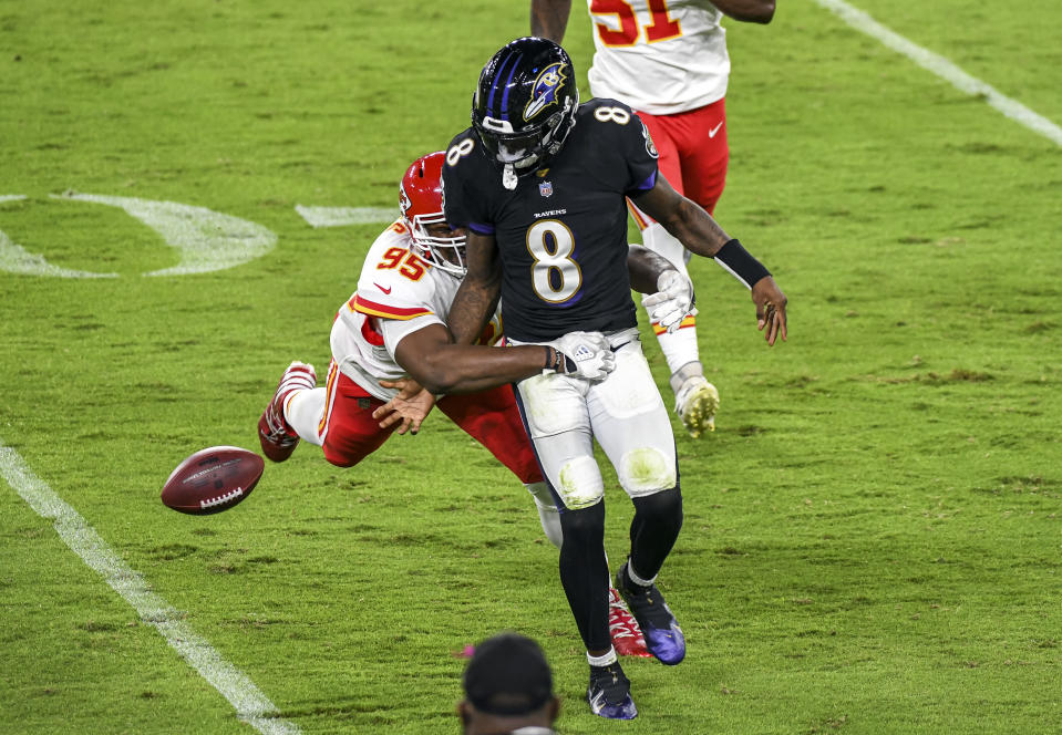 Lamar Jackson is stripped of the ball during a play.