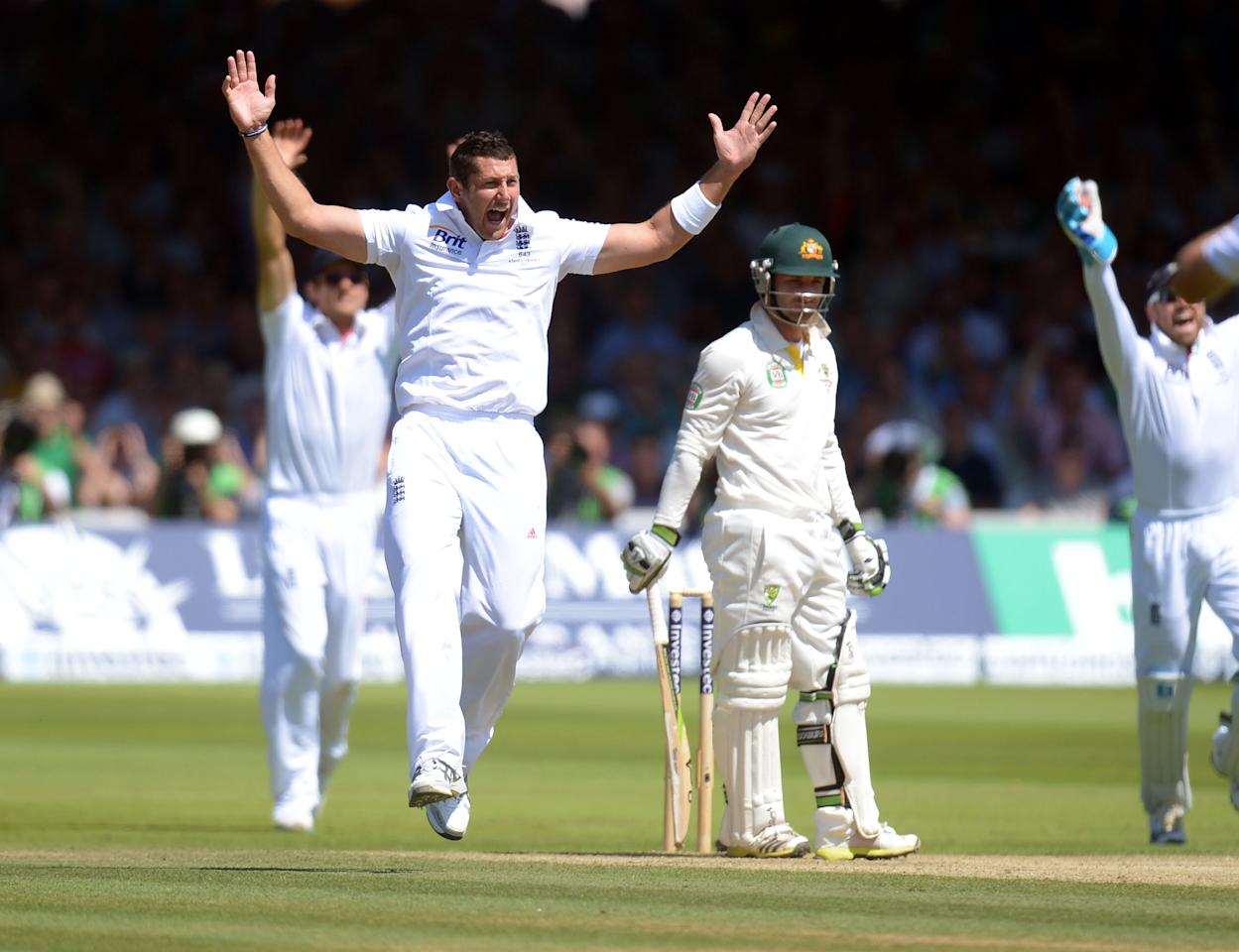 England's Tim Bresnan celebrates taking the wicket of Australia's Phil Hughes on day two of the Second Investec Ashes Test at Lord's Cricket Ground, London.