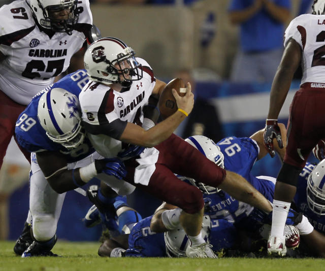 LEXINGTON, KY - SEPTEMBER 29: Connor Shaw #14 of the South Carolina Gamecocks is sacked by Donte Rumph #99 of the Kentucky Wildcats at Commonwealth Stadium on September 29, 2012 in Lexington, Kentucky. (Photo by John Sommers II/Getty Images)