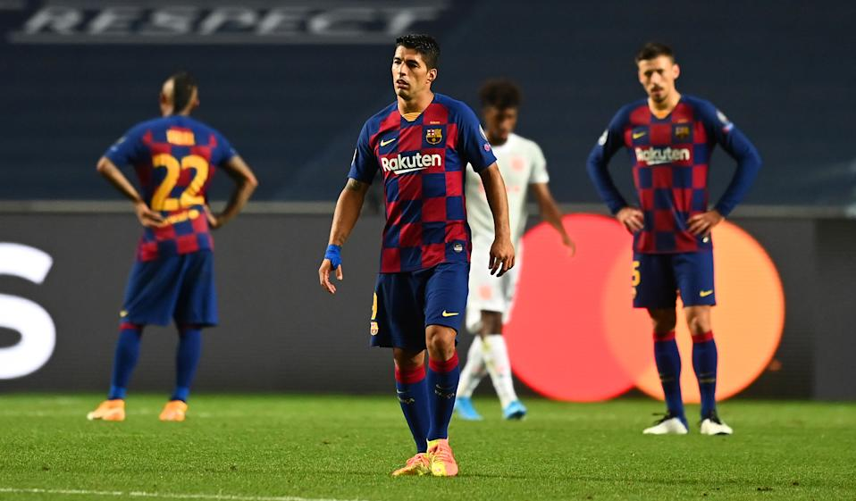 LISBON, PORTUGAL - AUGUST 14: Luis Suarez of FC Barcelona looks dejected during the UEFA Champions League Quarter Final match between Barcelona and Bayern Munich at Estadio do Sport Lisboa e Benfica on August 14, 2020 in Lisbon, Portugal. (Photo by Michael Regan - UEFA/UEFA via Getty Images)