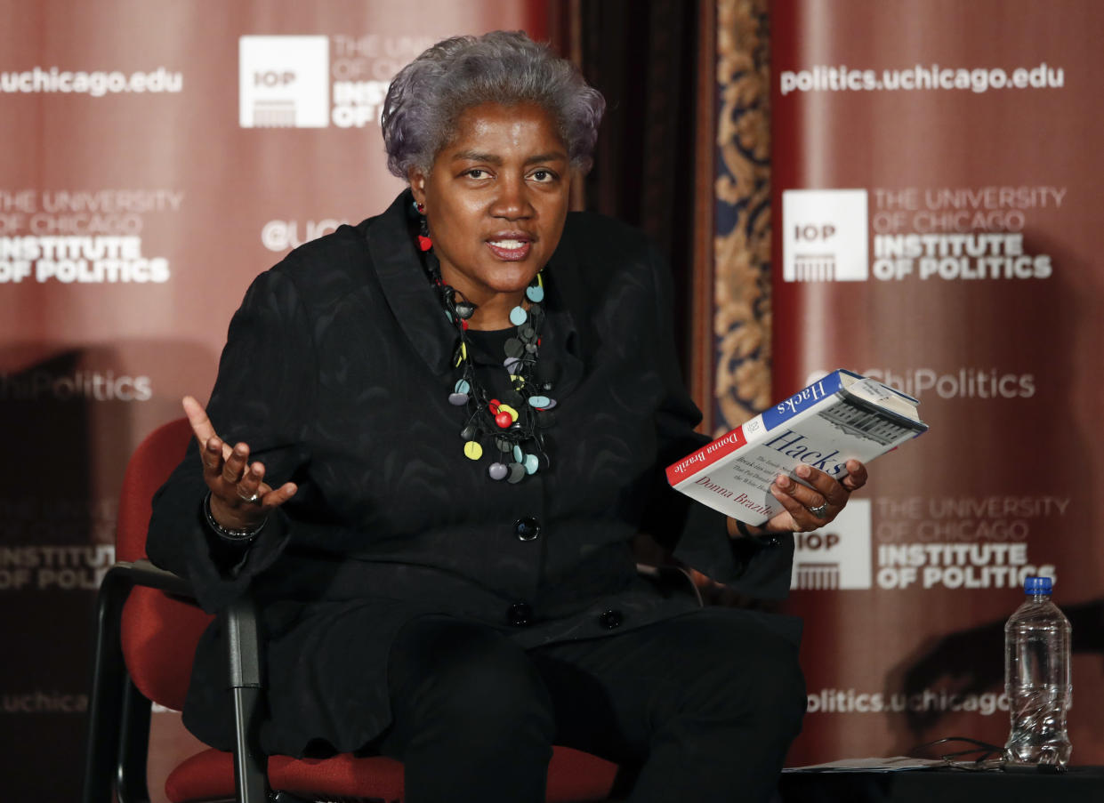 """<span class=""""s1"""">Former DNC Chair Donna Brazile speaks at the University of Chicago on Nov. 13, holding her just-published book, """"Hacks."""" (Photo: Kamil Krzaczynski/Getty Images)</span>"""