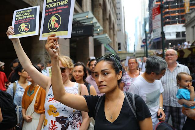 <p>Nicole of Queens carrying a sign in a rally against President Trump's policy of separating immigrant families on 42nd Street in New York City on June 20, 2018. (Photo: Gordon Donovan/Yahoo News) </p>