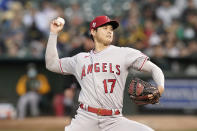 Los Angeles Angels' Shohei Ohtani pitches against the Oakland Athletics during the fifth inning of a baseball game in Oakland, Calif., Monday, July 19, 2021. (AP Photo/Jeff Chiu)
