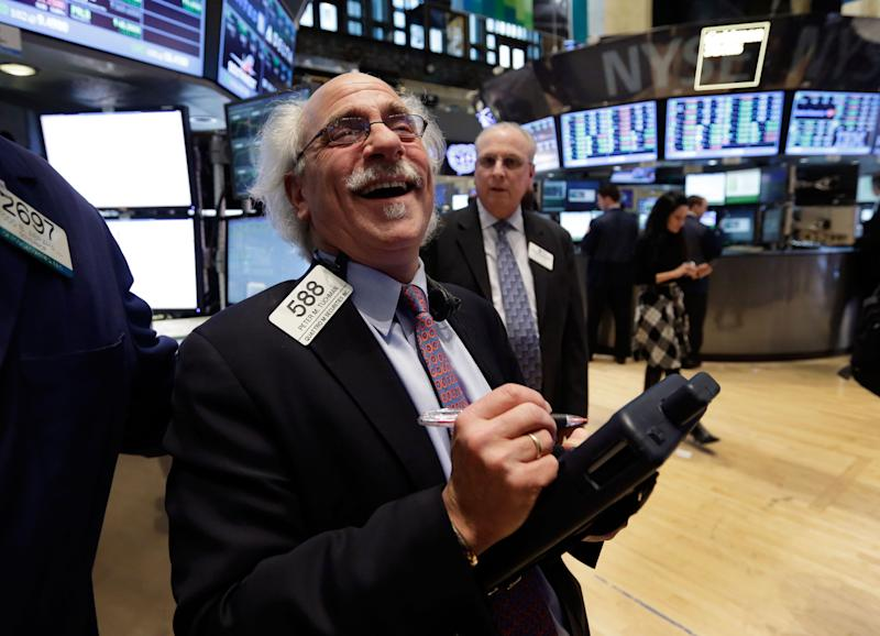 Trader Peter Tuchman smiles as he works on the floor of the New York Stock Exchange Tuesday, March 5, 2013. Five and a half years after the start of a frightening drop that erased $11 trillion from stock portfolios and made investors despair of ever getting their money back, the Dow Jones industrial average has regained all the losses suffered during the Great Recession and reached a new high. (AP Photo/Richard Drew)