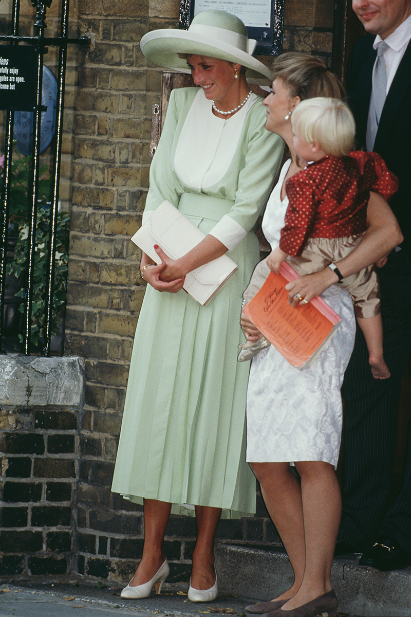 <p>Princess Diana famously nailed the wedding guest fashion brief, and this mint green and cream look (complete with the matching hat) is a case in point.</p>