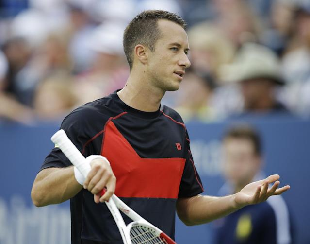 Philipp Kohlschreiber, of Germany, reacts after a shot against John Isner, of the United States, during the third round of the 2014 U.S. Open tennis tournament, Saturday, Aug. 30, 2014, in New York. (AP Photo/Darron Cummings)
