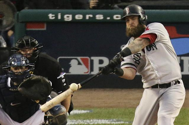 Boston Red Sox's Mike Napoli hits a home run in the seventh inning during Game 3 of the American League baseball championship series against the Detroit Tigers Tuesday, Oct. 15, 2013, in Detroit. (AP Photo/Charlie Riedel)