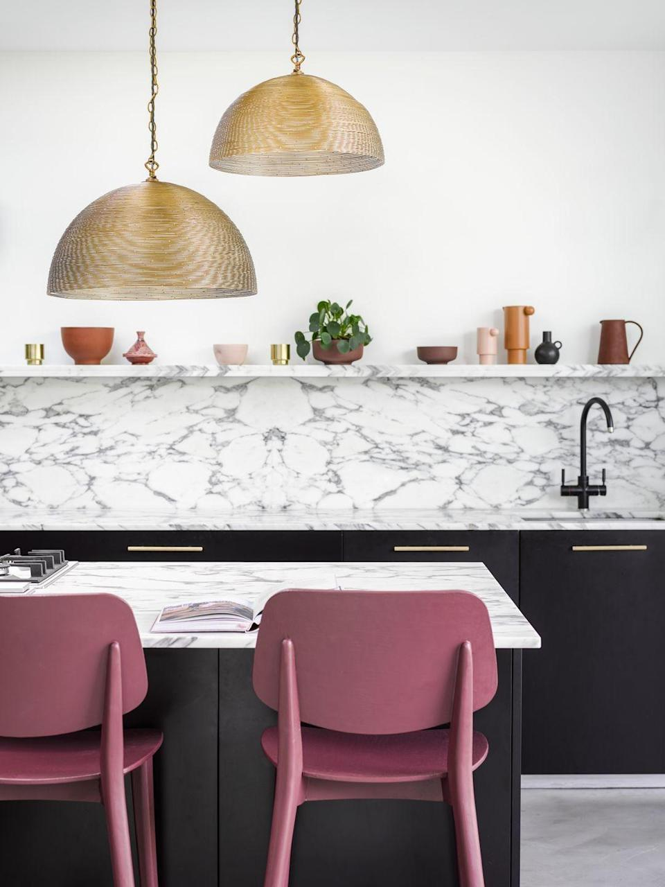 """<p>'Islands play an essential part in functional kitchens providing a handy area to prepare food, store extra equipment or even sit and eat,' explains Naomi.</p><p>'By including an island or breakfast bar in the kitchen design also helps to create a partition between kitchen and living space. This will help define areas of the room without closing in the kitchen or blocking off the rest of the room.'</p><p>• Large spangle pendant from <a href=""""https://go.redirectingat.com?id=127X1599956&url=https%3A%2F%2Fwww.pooky.com%2F&sref=https%3A%2F%2Fwww.housebeautiful.com%2Fuk%2Fdecorate%2Fkitchen%2Fg36940747%2Fkitchen-island-ideas%2F"""" rel=""""nofollow noopener"""" target=""""_blank"""" data-ylk=""""slk:Pooky"""" class=""""link rapid-noclick-resp"""">Pooky</a> </p>"""