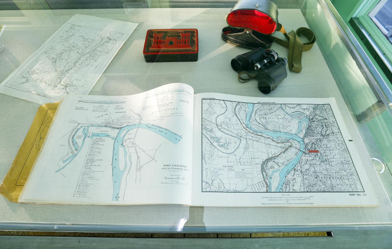 In this Dec. 18, 2012 photograph, visitors can see a book of river maps and charts in the pilot house of the Motor Vessel Mississippi IV at the Lower Mississippi River Museum in Vicksburg, Miss. The museum provides visitors with a extensive look at life surrounding the Mississippi River through several centuries by way of its interactive and static displays. (AP Photo/Rogelio V. Solis)
