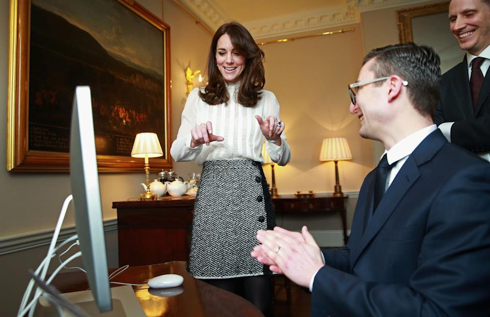 The Duchess of Cambridge talks to James Martin, Executive Editor of Huff Post UK and Steven Hull (right), Editor in Chief of Huff Post UK, as she guest edits The Huffington Post for the day in a temporary newsroom set up in Kensington Palace.