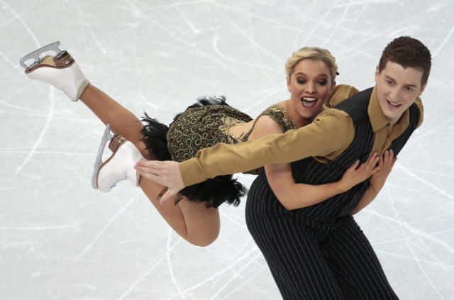 Danielle O'Brien and Gregory Merriman of Australia compete in the ice dance short dance figure skating competition at the Iceberg Skating Palace during the 2014 Winter Olympics, Sunday, Feb. 16, 2014, in Sochi, Russia. (AP Photo/Ivan Sekretarev)