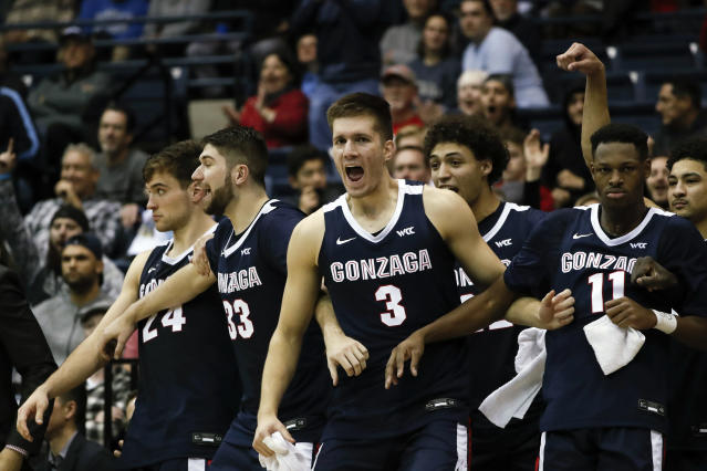 FILE - In this Jan. 9, 2020, file photo, Gonzaga forward Filip Petrusev (3) celebrates with teammates during the second half of an NCAA college basketball game against San Diego, in San Diego. Gonzaga finished second in The Associated Press college basketball poll, Wednesday, March 18, 2020. (AP Photo/Gregory Bull, File)