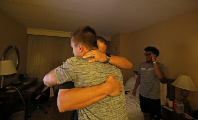 Texas Longhorns head coach Tom Herman hugs players Sam Ehlinger and Casey Thompson (right) goodnight Friday Sept. 6, 2019 at the team hotel in Austin, Tx. ( Photo by Edward A. Ornelas )