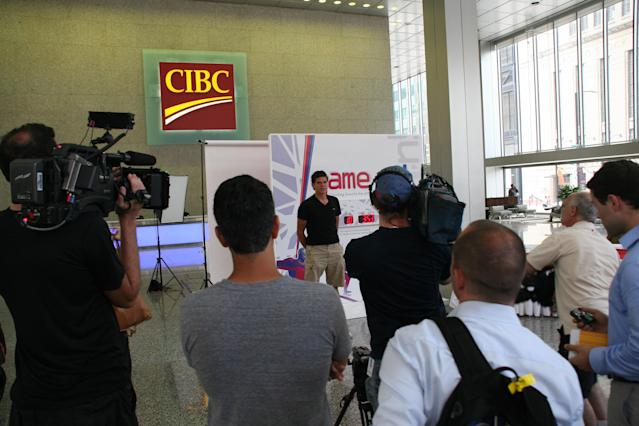Milos Raonic speaks with the media at Commerce Court in Toronto. (Photo Courtesy Alex Jones Photography)