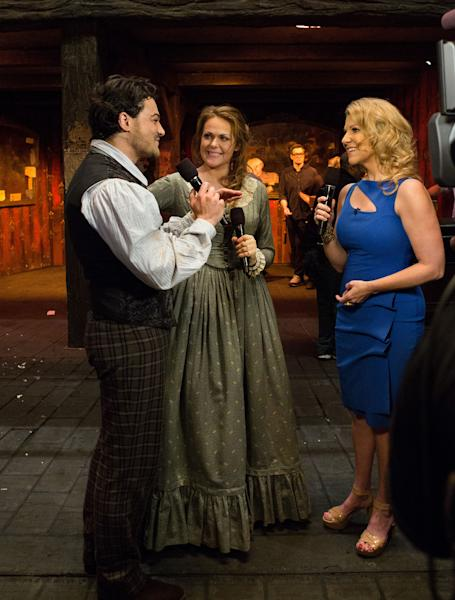"""In this photo provided by the Metropolitan Opera, """"Perspectives"""" series host and Mezzo-soprano Joyce DiDonato, right, interviews Vittorio Grigolo and Kristine Opolais during the first intermission of the Met's Live in HD transmission of Puccini's """"La Boheme,"""" Saturday, April 5, 2014 in New York. Opolais made Metropolitan Opera history Saturday, stepping in for an ailing soprano to make her second company role debut in a span of 24 hours. On Friday night, Opolais sang Cio-Cio-San in Puccini's """"Madama Butterfly."""" (AP Photo/Metropolitan Opera, Marty Sohl)"""