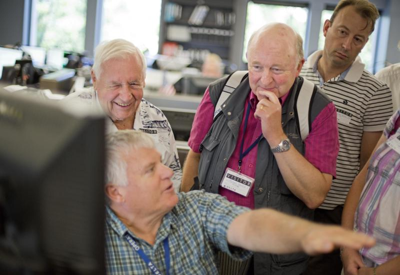 In this Friday, Sept. 20, 2013 photo, airport chaplains Deacon James O'Malley, rear left, of Chicago, and Rev. Michael Banfield, with his hand to his face, of London's Luton Airport, listen to flight superintendent Ed Sullivan explain the Operations Customer Center while attending the International Association of Civil Aviation Chaplains' annual conference at the Delta Air Lines' headquarters, in Atlanta. Airports are mini-cities with their own movie theaters, fire departments and shopping malls. Many also have chapels, which are staffed by a mix of 350 part- and full-time chaplains worldwide who are Catholic, Protestant and, to a lesser extent, Jewish, Muslim or Sikh. (AP Photo/David Goldman)