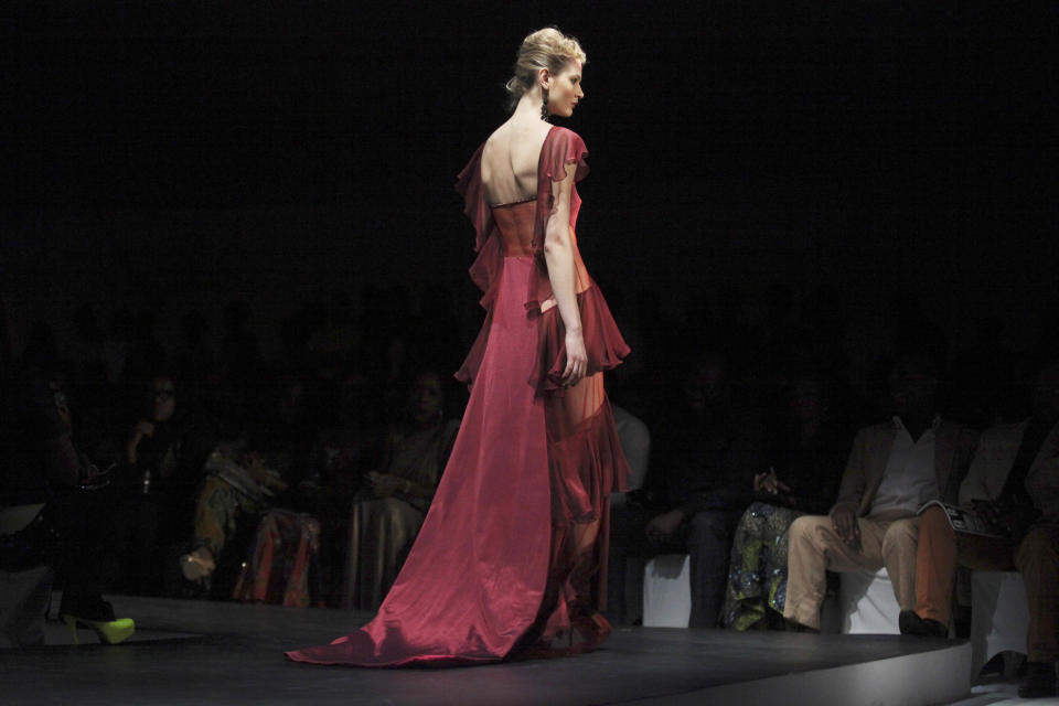 A model displays an outfit at the ARISE Fashion Week event in Lagos, Nigeria on Sunday, March 11, 2012. (AP Photos/Sunday Alamba)